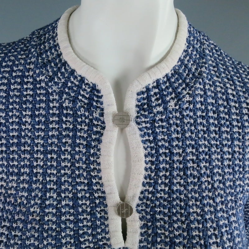 "Lovely nautical sweater by CHANEL. In a medium weight blue and white cotton blend, featuring 3/4 sleeves, white piping, and a henley collar that closes with two silver tone ""CC"" buttons and matching silver plaque at the hem. Perfect for Spring"