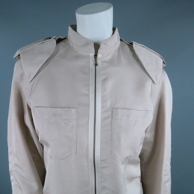 Lovely khaki silk jacket by LANVIN Ete 2006. A classic twist style based on a trench coat, this piece features a band collar, exterior shoulder pads with epauletes, Exposed zipper closure, patch breast pockets, and back pleat detail. Great for