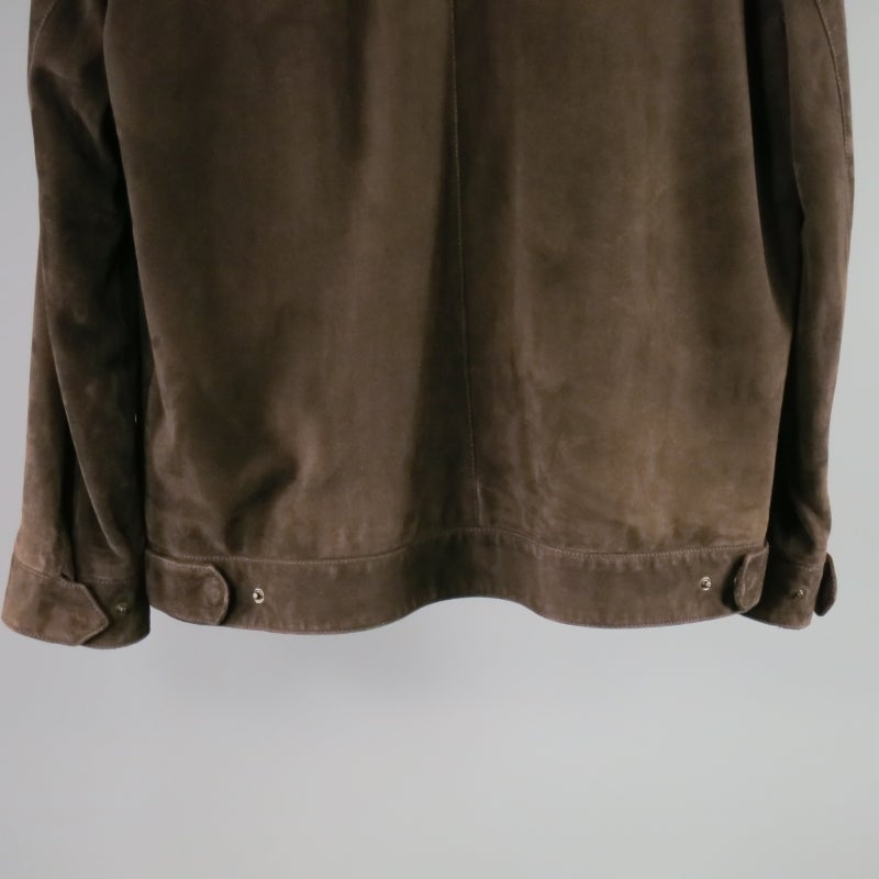 Classic brown leather jacket by Loro Piana. A collared worker style with double zip closure featuring tarnished gold hardware, tortoise logo buttons on sleeves and back tabs, side slit pockets, detachable zip off collar and tan cashmere lining with