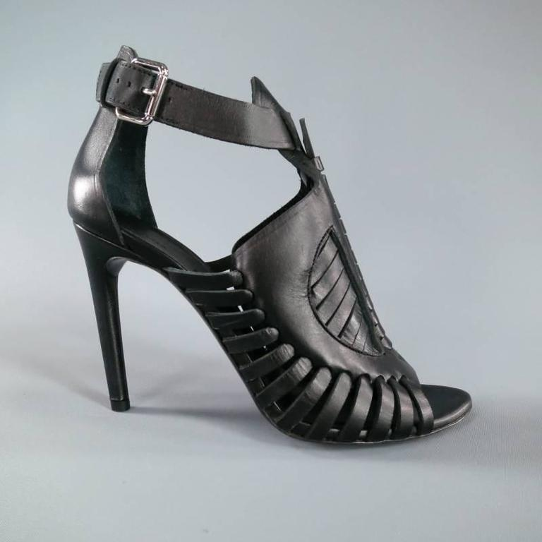 Ultra chic high heeled runway sandals by PROENZA SCHOULER. This sleek style comes in structured black leather and features a gorgeous woven detailed front with peep toe, straight heel, and ankle buckle. Made in Italy.   Brand New w/Box.   Heel: