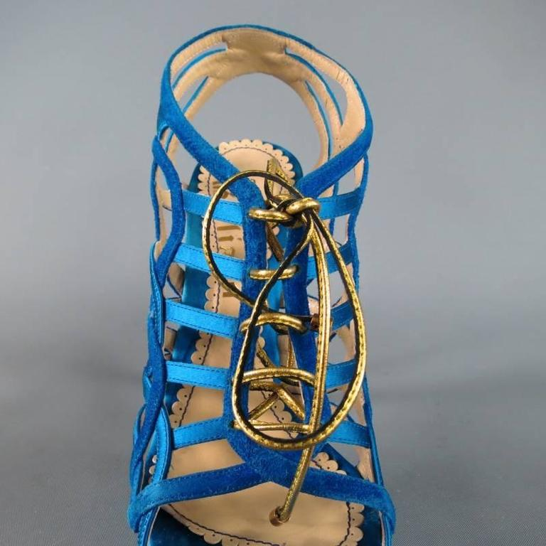 Fabulous open toe platform sandals by John Galliano. A sexy style in gorgeous aqua teal silk and suede these caged ankle booties feature artsy interlocking straps, gold leather laces, and covered platform and stiletto heel. With Box. Made in Italy.