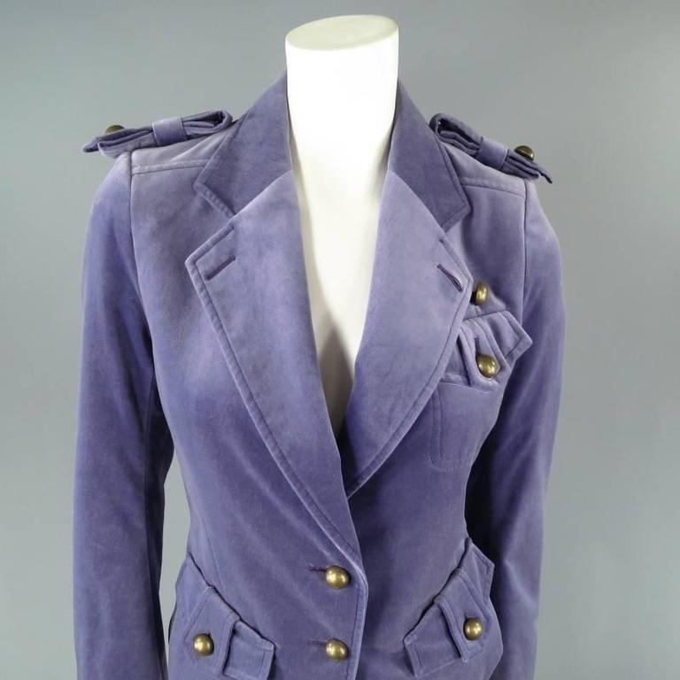 Fabulous cropped military jacket by YVES SAINT LAURENT. A rare piece from the TOM FORD archives, this piece comes in a beautiful violet lavender velvet and features a notch lapel, bow epaulets, symmetrical hip flap pockets with tarnished gold tone