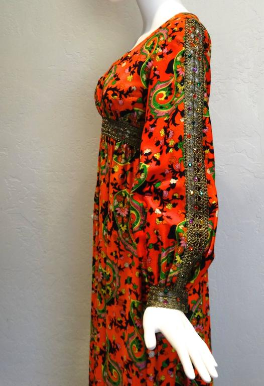Beautiful vintage Miss Magnin for I.Imagnin maxi dress! Hermes orange bodice, with 3-D 'paisley and floral design mixed together to create a stunning vintage print. Around the waist and down each sleeve like tiny gems in a spiders web, there are