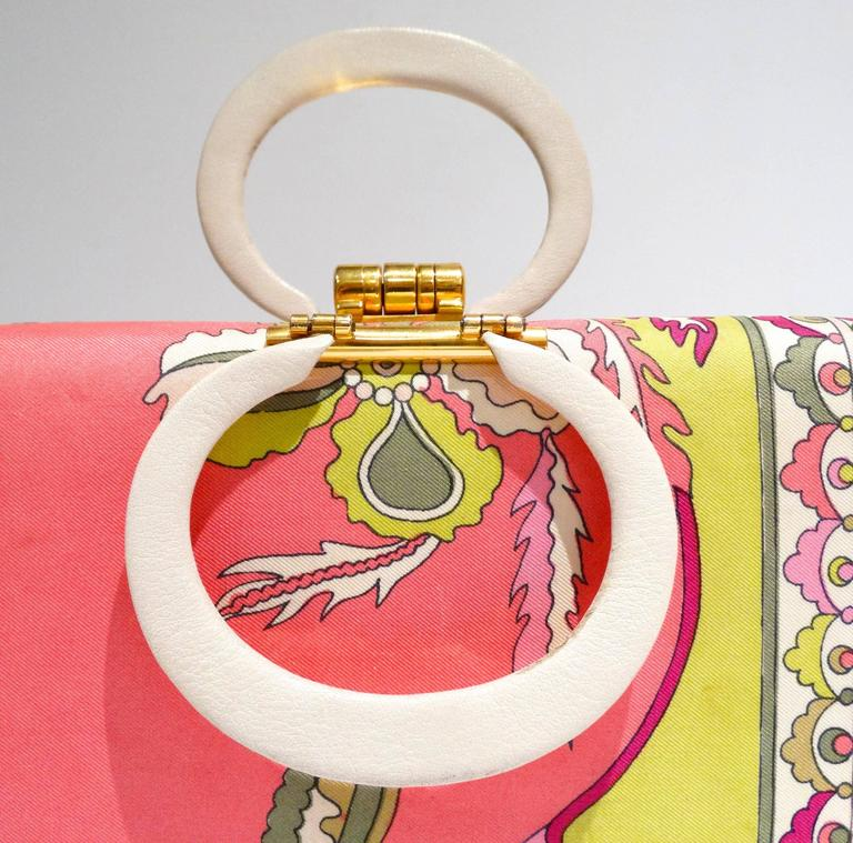 """Who doesn't love vintage Pucci??? Especially handbags! This adorable little 60's vintage Pucci box purse is covered with silk fabric with gorgeous pinks, yellows, & white. Inside is buttery soft leather with gold lettering """"Italy"""" & Pucci's"""