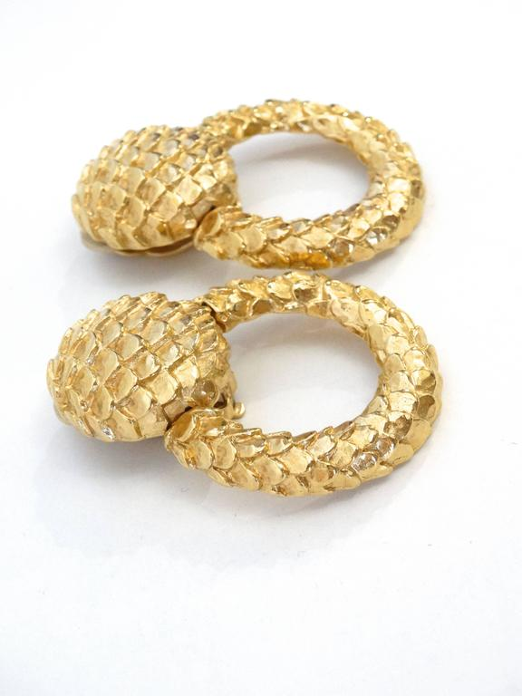 Statement hoops by Givenchy circa 1980s with a magnified snakeskin texture. Plated in gold, these hoops are sure to get noticed! 