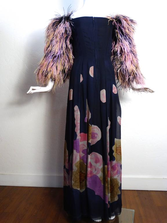 This beautiful 1980's Hanae Mori dress is to die for... all hand painted on silk with  a beautiful floral motif. Ostrich feather sleeves in lovely pinks, purples and creams. Sleeve is off the shoulder and features two thin straps that can be worn on