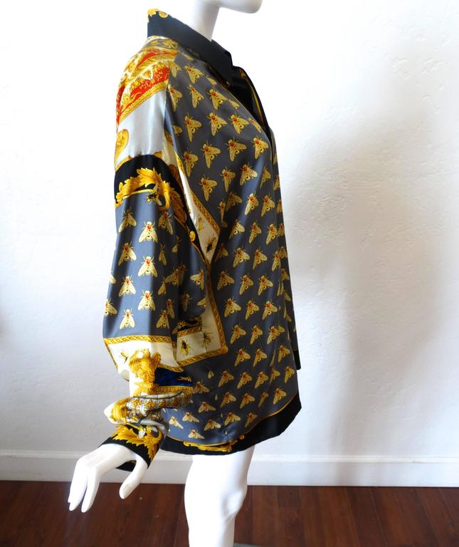 GIANNI VERSACE 1995 silk shirt Napoleon I on the Imperial Throne from the Knights and Military collection 100% silk Size Ita 48  Approximate measurements with garment lying flat:  Shoulder width (measured from shoulder seam to shoulder seam) =