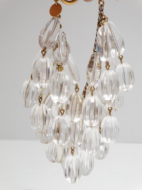 "1980's ANNE KLEIN COUTURE Clear lucite carved beads and Gold-plate Metal Chain Beaded Runway Bracelet A TRUE WORK OF ART COMPOSED OF MULTIPLE STRANDS OF HUGE CARVED TEAR-SHAPED CLEAR LUCITE BEADED STRANDS (2 1/4"" in length each) DANGLING FROM A GOLD"