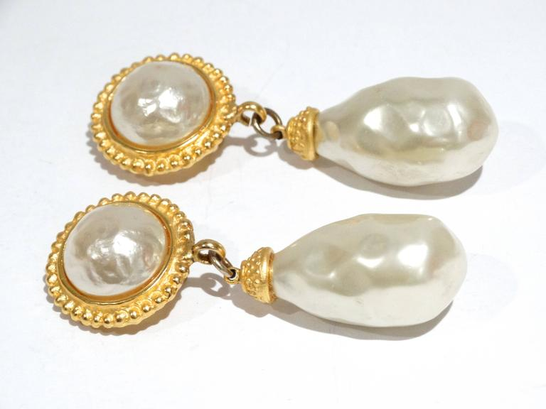 A fabulous pair of 1990's Deanna Hamro Gold Tone Faux Pearl Earrings  Deanna grew up at the beach in Southern California, embarking on a modeling career at an early age leading her to live abroad and travel the globe.  3