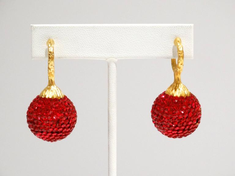 A fabulous pair of 1990's Deanna Hamro Ruby Red Crystal Ball Diamante Gold Tone Earrings, For pierced ears only, plated in gold. This beautiful pair of earrings are show stoppers. Deanna Hamro grew up at the beach in Southern California, embarking