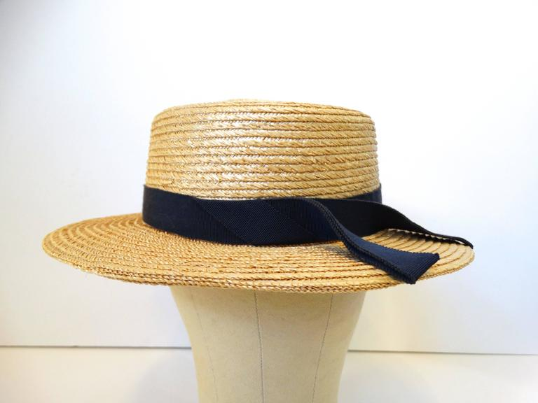 Rare 1980's Yves Saint Laurent Rive Gauche boater straw hat with a contrasting navy ribbon. Made In France. Style/model A458 Measures: 14