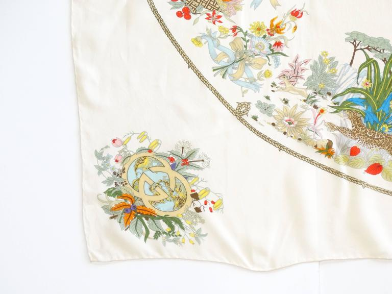 Delicate and beautiful V. ACCONERO design for GUCCI, rare silk chiffon with hand rolled edges 40' square with beautiful motifs of florals, the sea, the jungle and golden harvest. Designed in the 60's printed in the early 70's. Gucci Logo motif in