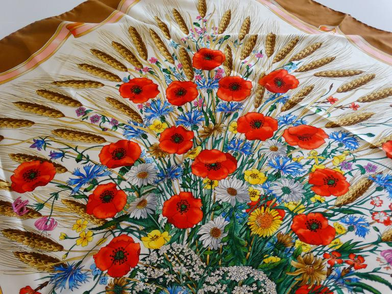 Early 1970's Scarf  Spighe, Wheat ears printed on silk,  gorgeous bouquet of poppy flowers and wheat coming out of one corner and around it. Desined by the famous renowned illustrator Vittorio Accornero rich colors of neutrals and peach. This large