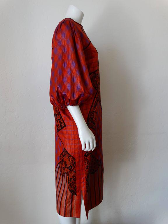Avant Garde 1980s Diane Freis runway patchwork dress! Billowing balloon sleeves in bold red and violet gingham print. Patches of stripes, leaf-like print and grid. Dress pulls over the head with keyhole closure at the back of the neckline. Made in