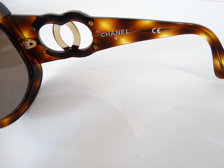 Fabulous 1990s Chanel Tortoise Shell Sunglasses. Mod square shape. Signature Chanel Logo in gold at either arm.Width of glasses from temple to temple is 5 inches. Some of the print on the inside has faded off, part of the id number (first 5 digits)