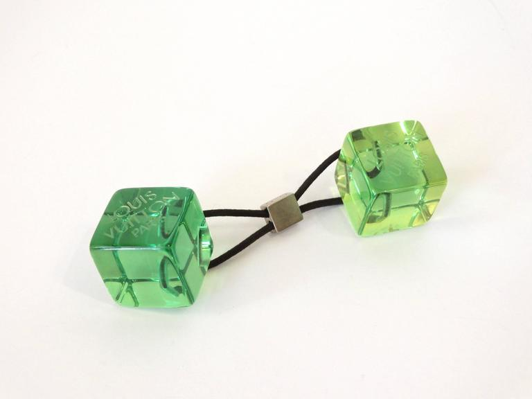 Add some fun to your hair with this adorable Louis Vuitton Green Resin Hair Cube! Louis Vuitton Paris etched into the resin. Stretchy hair band. Measures  5in length.