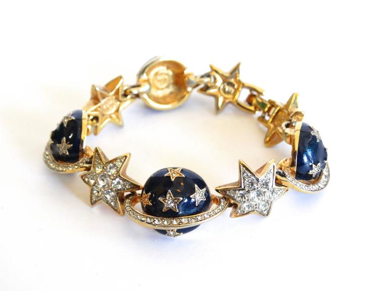 When the stars aline you find this fabulous Butler & Wilson Saturn and Star bracelet. Gold metal topped with blue enamel planets and dazzling rhinestone stars. I have listed the matching earrings, if you would like a set.   6.5 inches Long