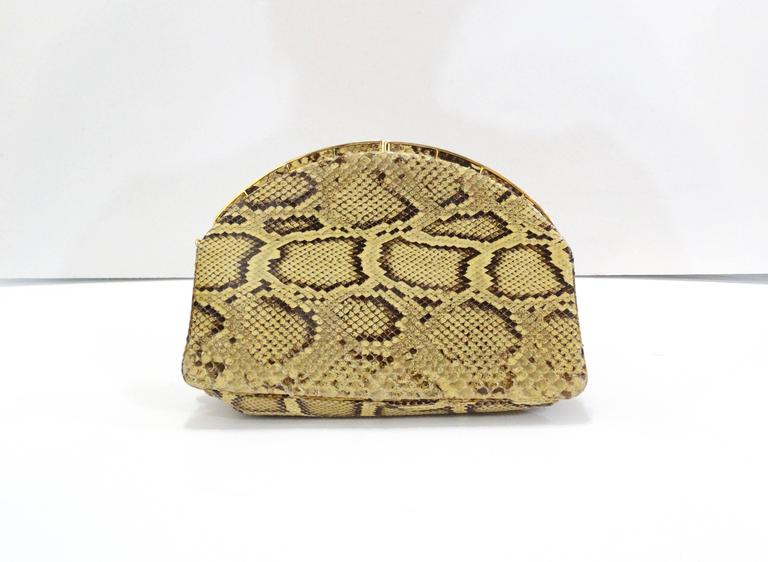 Gorgeous Judith Leiber evening bag made of genuine python snakeskin! Easily worn across the body with thin gold chain. Frame-type clasp closure that snaps open and closed. Chain is easily detached and tucked away for use as a clutch. Comes with it's