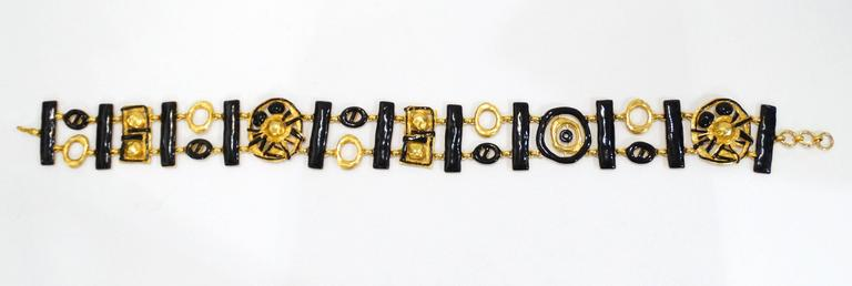 Rare and Fabulous this late 1980's Christian LaCroix chain belt with abstract geometric charms. This belt is cast in brilliant gold plated metal topped with black enamel details. Chain and hook closure. Signed Christian Lacroix Made in France!