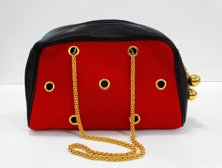 1980s Moschino Red Grommet Bag In Excellent Condition For Sale In Scottsdale, AZ
