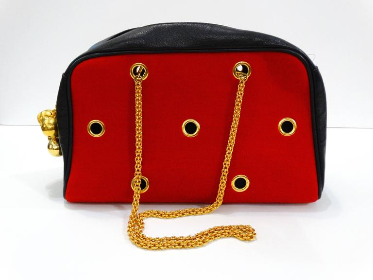 Women's or Men's 1980s Moschino Red Grommet Bag For Sale
