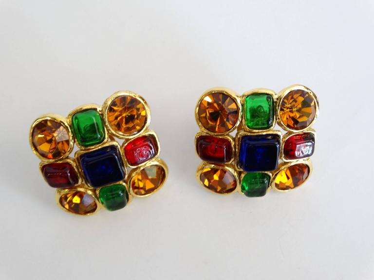 Rarestyle of a beautiful pair of clip on earrings by Chanel featuring a cluster of bezel set multi-colored glass jewels.  Stamped and marked Chanel Made in France