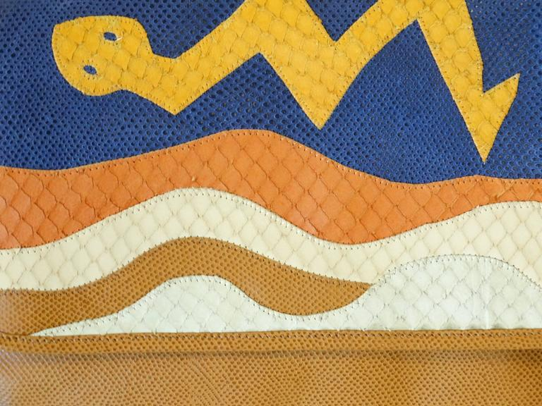 Wild Wild West... Gorgeous and unique vintage CARLOS FALCHI purse. This purse is made of leather and has a depiction of a snake on the front. The purse is in excellent condition with no damage. One interior zip pocket, signed lining