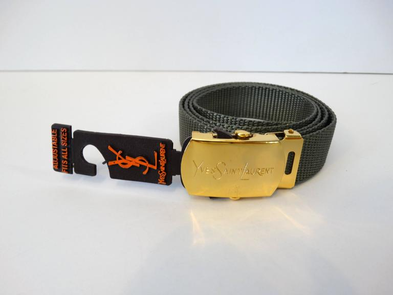 Rare dead-stock YSL adjustable nylon woven belt with gold buckle. The size is OSFA but the best waist is 25