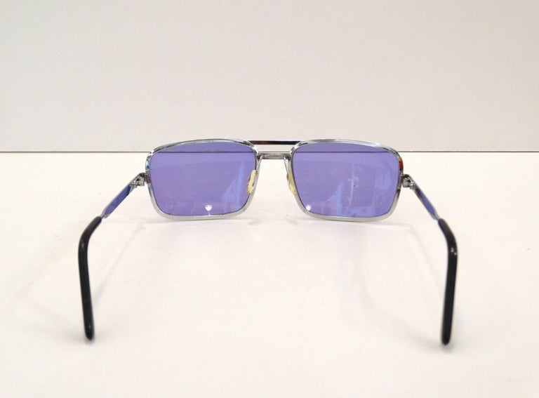 Rock the colored sunglasses trend with these sexy 1990s rectangular lenses in a brilliant violet! Quality silver metal frames, brand unknown. Marked Made in France