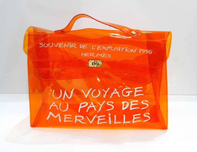 Make a statement with this 1990s Hermes Souvenir Kelly bag! This piece is highly collectable- in the coveted orange color-way. These bags were limited edition, this color was made for the 1998 exhibition in Paris and carried only in Japanese stores.
