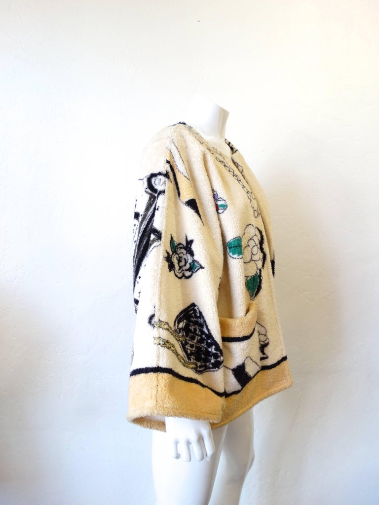 "This rare cream terry cloth Chanel beach/bathrobe jacket has the ""iconic"" Chanel print. (All of the classics are printed on this piece) Designed by Karl Lagerfeld in 1994 for Chanel's spring/summer collection. This robe has a thick cream trimmed"