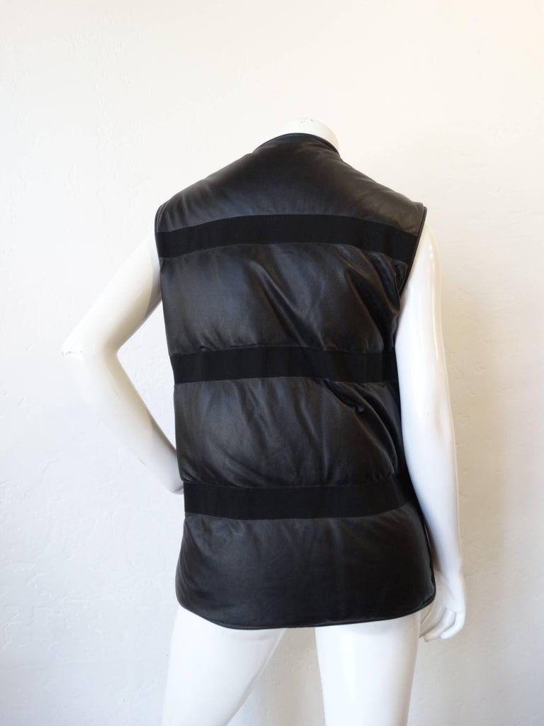A wonderful piece from Damir Doma. A python-lamb skin padded vest. This vest features python snake skin in beige/grey on the front and lamb skin leather on the back. Gunmetal zipper front with side panel zippers. design feature front pockets with
