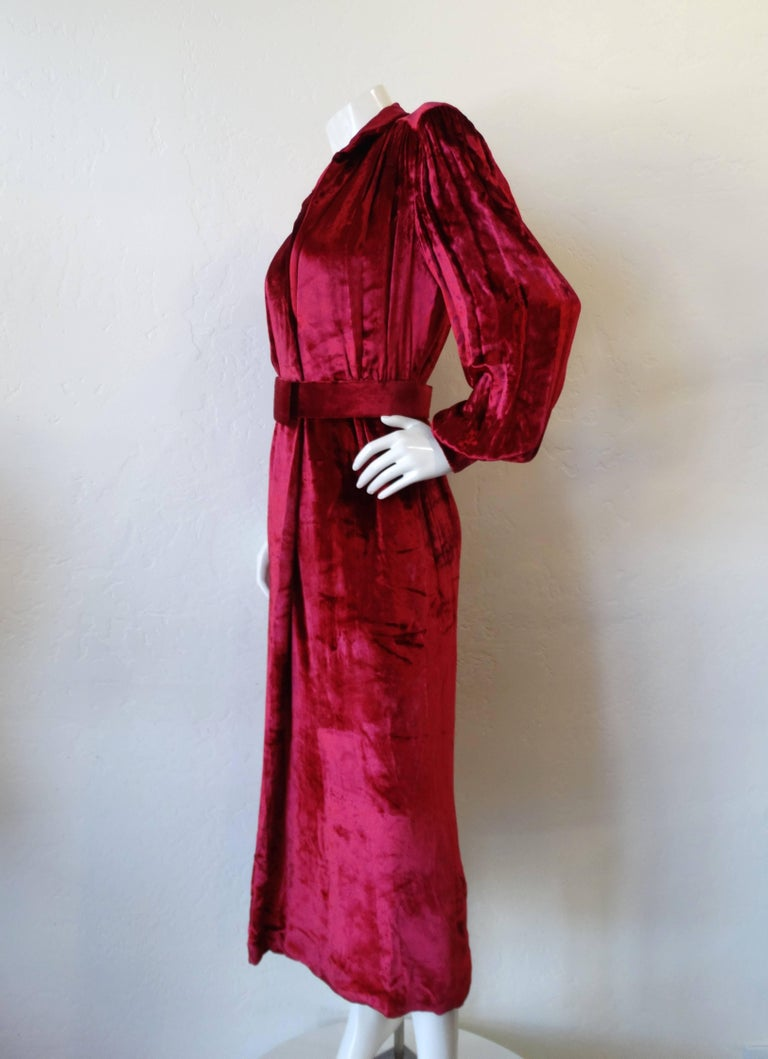 This is an absolutely stunning vintage dress from William Travilla from the 1980's! This incredible Boudreaux velvet dress has a deep v neckline, with detachable velvet belt to finish the look. The dress has a back slit and is such a great piece to