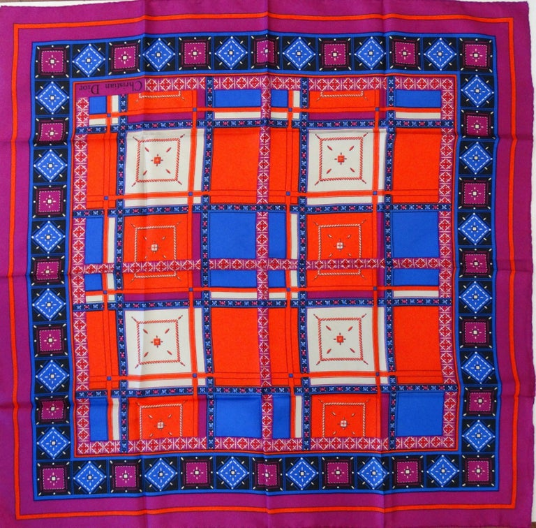 Gorgeous 1980s Christian Dior geometric jewel printed scarf! Printed in hues of magenta, blue, white and red- this piece makes a statement! This scarf is versatile with a capital V! Wear as a headscarf, tied on your bag, as an ascot- you choose!   H