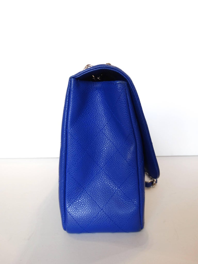 a4b0fcff8a25 This bag is classic meets modern  with it s signature Chanel 10C Caviar  Jumbo Classic in