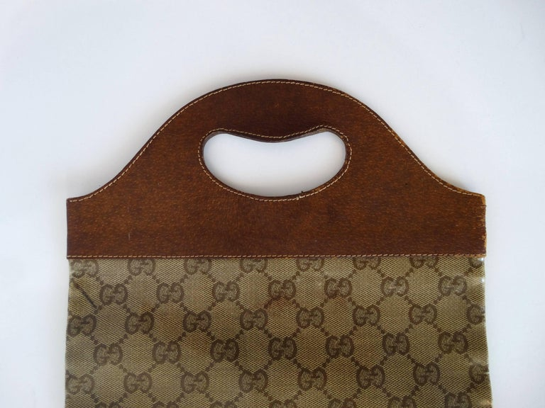 Women's 1970s Gucci Monogram Canvas Vinyl Fold-over Hand Bag For Sale