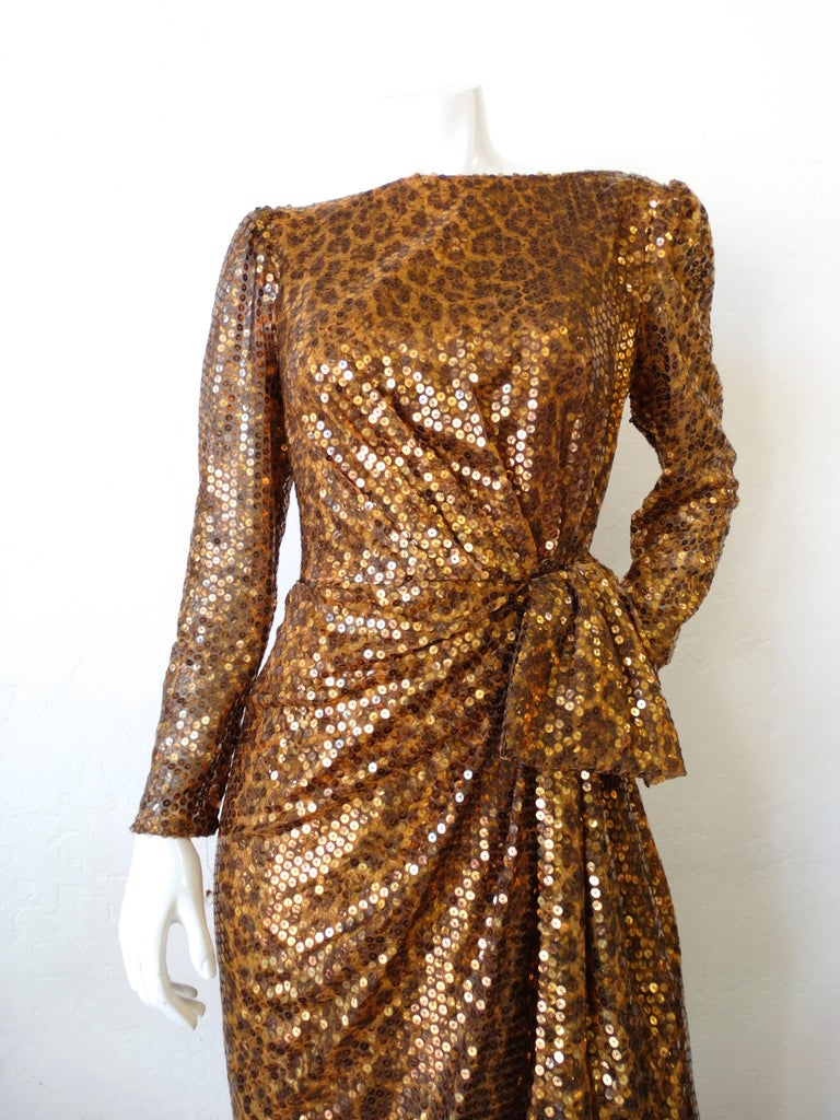 What's better than leopard? Leopard AND sequins of course! Rock the holidays in our incredible 1980s Saks Fifth Avenue x Mignon dress! Made of a subtle leopard fabric bedazzled completely in iridescent gold sequins. The fit of this dress is