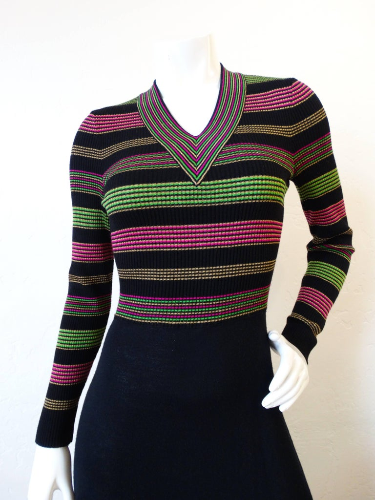 Channel the spirit of the 1970s with our adorable Saks Fifth Avenue lurex dress! Oh so 70s striped bodice woven from a metallic lurex knit in shades of gold, green and pink. Similar stripes on the hem of the skirt. Zips up the back, stretchy fabric