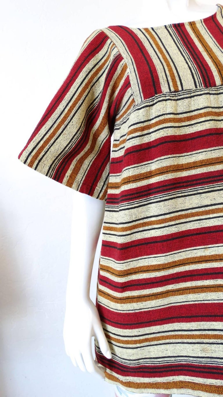We are obsessed with Israeli label Rikma- and you will be too with this amazing 1970s striped bell sleeve blouse! Made of a thick, quality woven cotton fabric with signature Rikma stripes in shades of red, mustard and black. Trapeze style silhouette
