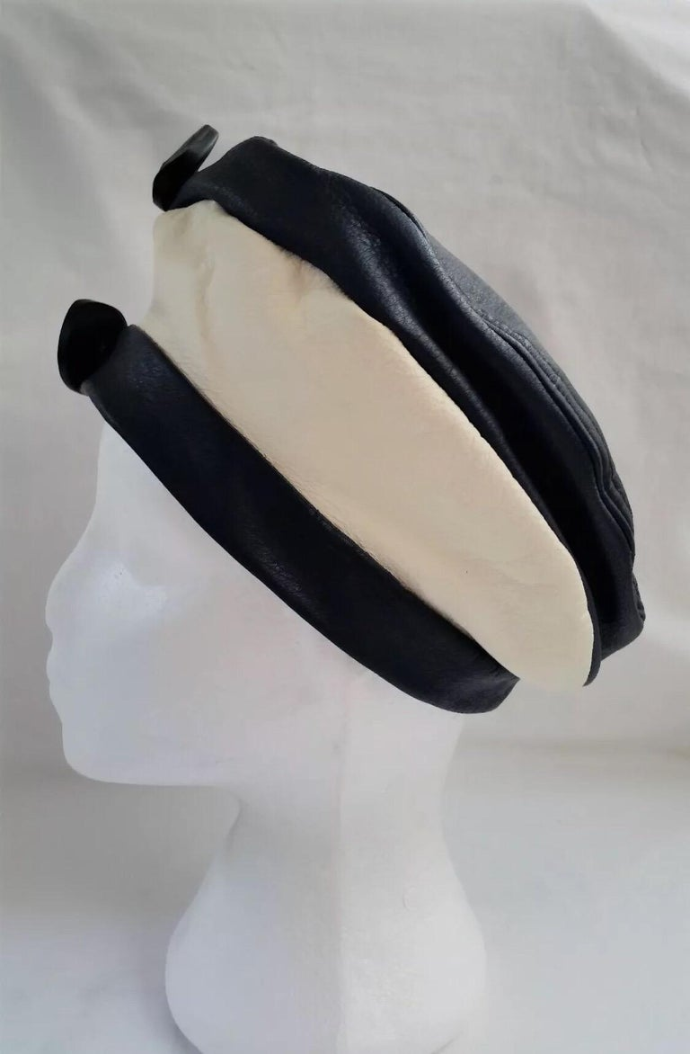 6d0dab7dbf8be Beautiful Navy Blue   White leather beret with 2 large navy blue buttons  feature on the