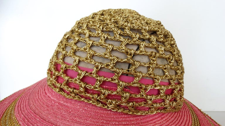 Okay ladies this is a gorgeous wide brim sun hat designed by Eric Javits circa 1980's. The color combo is stunning, pink and gold metallic with a crochet design for the crown. Hat is a size 7 measuring 21.58