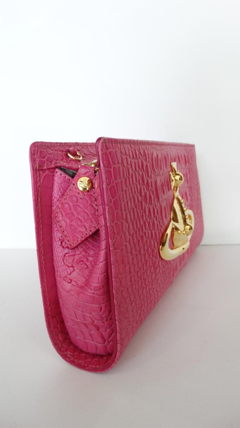 61427bb01d0 ... Clutch Bag For Sale. Make a statement with our Vivienne Westwood -  Classic Orb, pink moc croc embossed leather