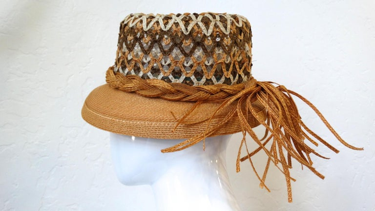 This amazing 1960s Yves Saint Laurent hat is a unique twist on the traditional boater style! Made of a quality woven straw material in contrasting shades of tan, brown and cream in an open weave at the top. Braided around the base of the hat with a