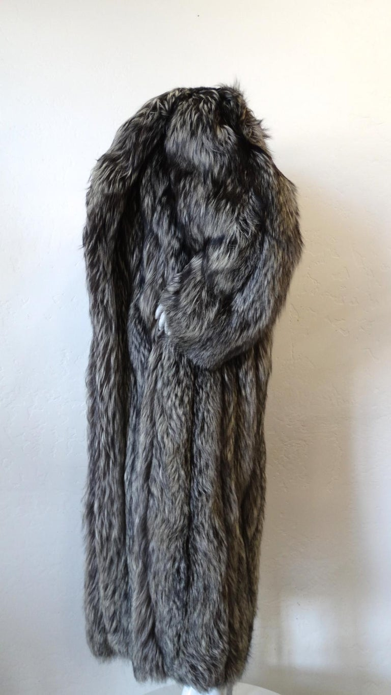 The most luxurious silver fox fur coat from designer James Galanos, circa 1980s! Super plush silver and black fox fur sewn in vertical lines up the front and back. Long length, oversized silhouette. Big, dramatic fur collar, perfect for draping off