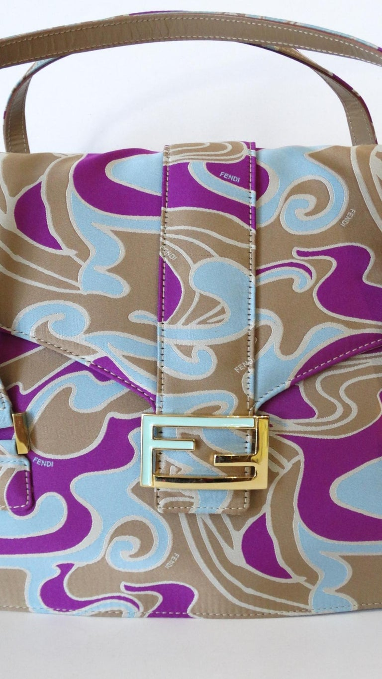 The Fendi flap bag is back! Rock a unique piece of your own with our incredible Fendi psychedelic swirl bag circa 2000s! Structured rectangular shape, covered in a soft canvas material. Printed all over in unique swirling pattern, in shades of
