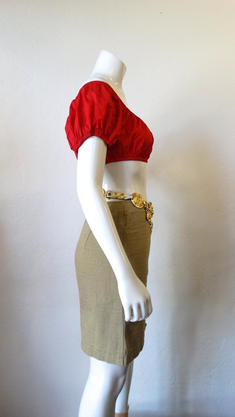 Who Does't Love A Great Crop Top!? Circa 1980s, from YSL's Variation line, this red crop top is a peasant style with cap puffed sleeves and rushing around the top and bottom hem. Perfect to pair with your favorite high waisted jeans, shorts or