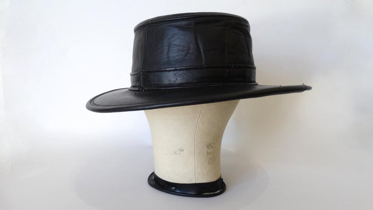 You Can Never Go Wrong With A Classic Black Hat! Created by Henschel, this black wide brim boater hat is made of genuine leather and has a lined interior. The perfect piece to throw on with any outfit! Made in the USA and marked a size Medium.