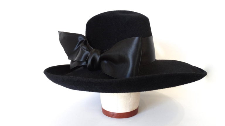 The Most Chic and Classic Hat Is Here! Circa 1960s, this wide brim bowler hat is made of genuine velour and features a large decorative bow around the crown. Perfect with any outfit! Made in Poland.  Note: This timeless hat brand was created by two