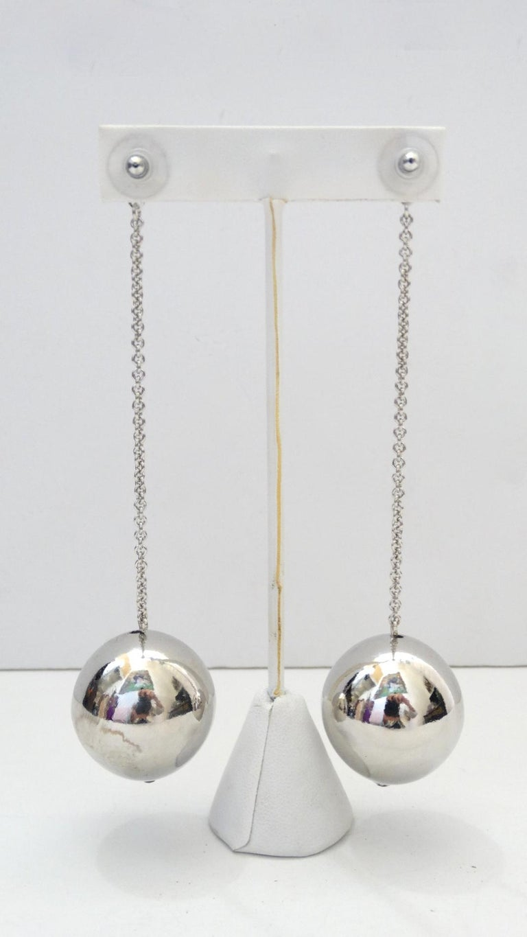 How fun are these lovelies?!  Silver plated, these earrings feature a chain link which is accented with a single ball at the bottom. Earrings are pierced, Designer unknown Drop down 4 inches