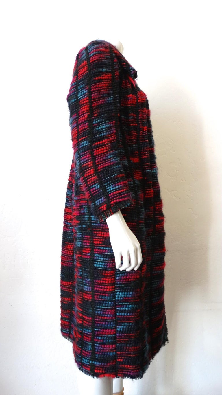 The Most Beautiful Coat Has Arrived! Circa 1980s, this Toledo coat is 100% Silk and handwoven. Features stands of multi-colored ombre fabric, front snap buttons down the front, and a frayed black bottom hem. Some seams are top stitched and left raw.